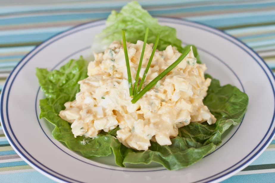 This creamy egg salad recipe makes a perfect light lunch in a sandwich or on a bed of lettuce. It's a great hardboiled egg recipe to use up leftover eggs!