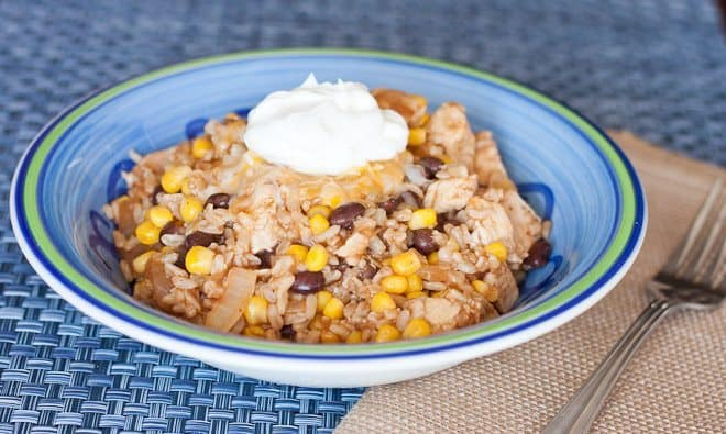 Chicken Enchilada Rice Recipe : So Very Blessed - This easy skillet meal combines chicken, brown rice, black beans, and enchilada sauce for a healthy weeknight dinner.