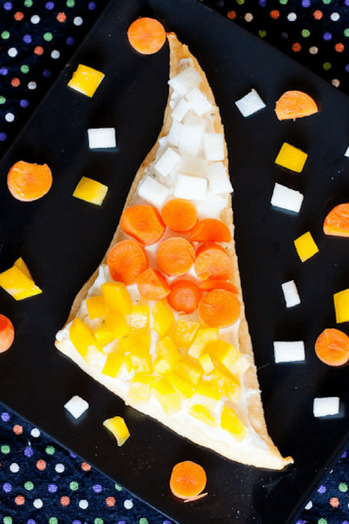 Candy Corn Veggie Pizza Recipe : So Very Blessed – These cute and easy to make veggie pizza slices topped with crunchy fresh vegetables make for a healthy Fall snack, side dish, or party food.