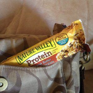 Nature Valley Peanut Butter Dark Chocolate Protein bar in a purse