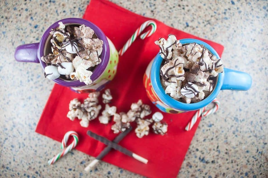 Hot Chocolate Popcorn : So Very Blessed - This festive popcorn is super simple, using hot chocolate mix and marshmallows, and it can be thrown together in minutes for a perfect party treat!
