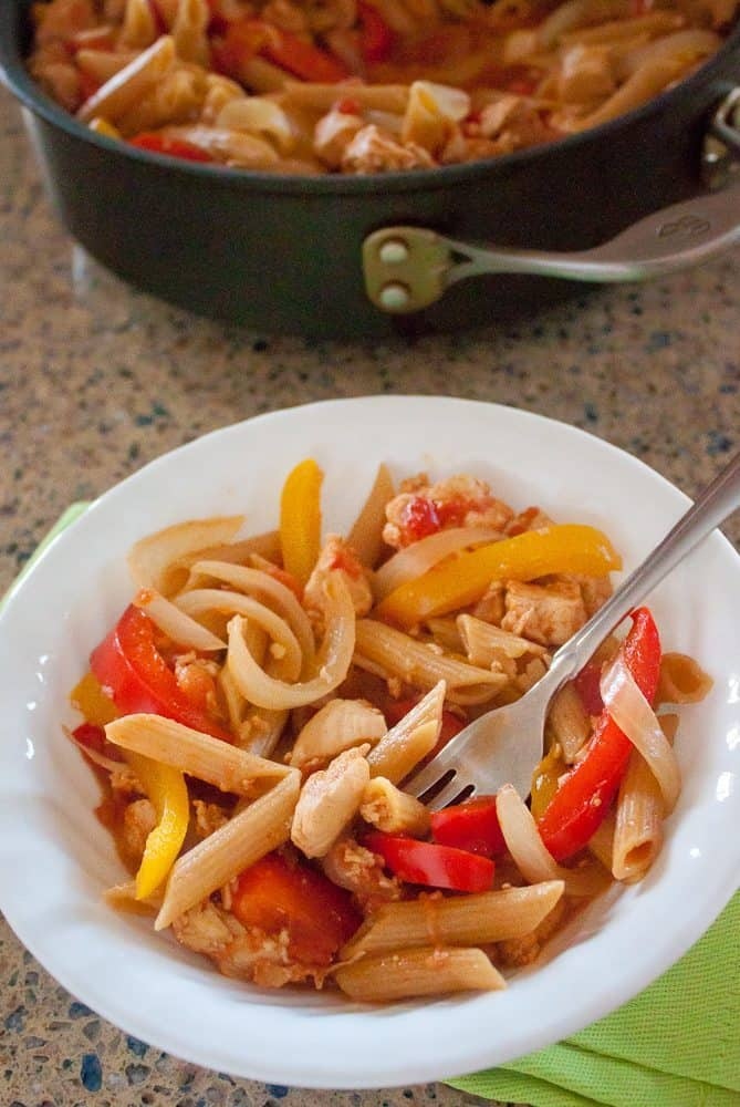 This Creamy Fajita Pasta with tender whole-wheat pasta, chicken, and bell peppers is an easy, healthy, and flavorful one-skillet meal.