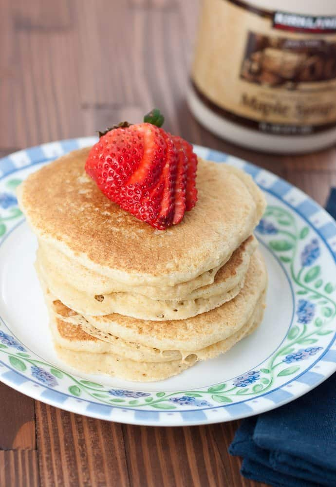 These Healthier Fluffy Pancakes are a great breakfast choice made with white whole wheat flour to keep them fluffy, delicious, and nutritious.