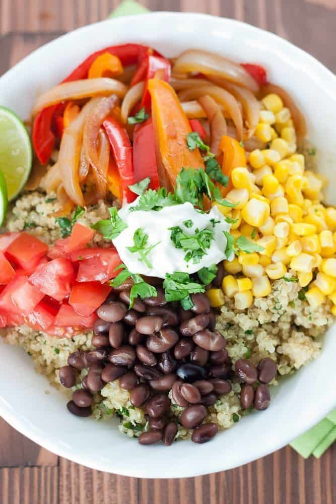 These Quinoa & Black Bean Burrito Bowls make a great healthy lunch or meatless dinner, full of fresh veggies and protein.