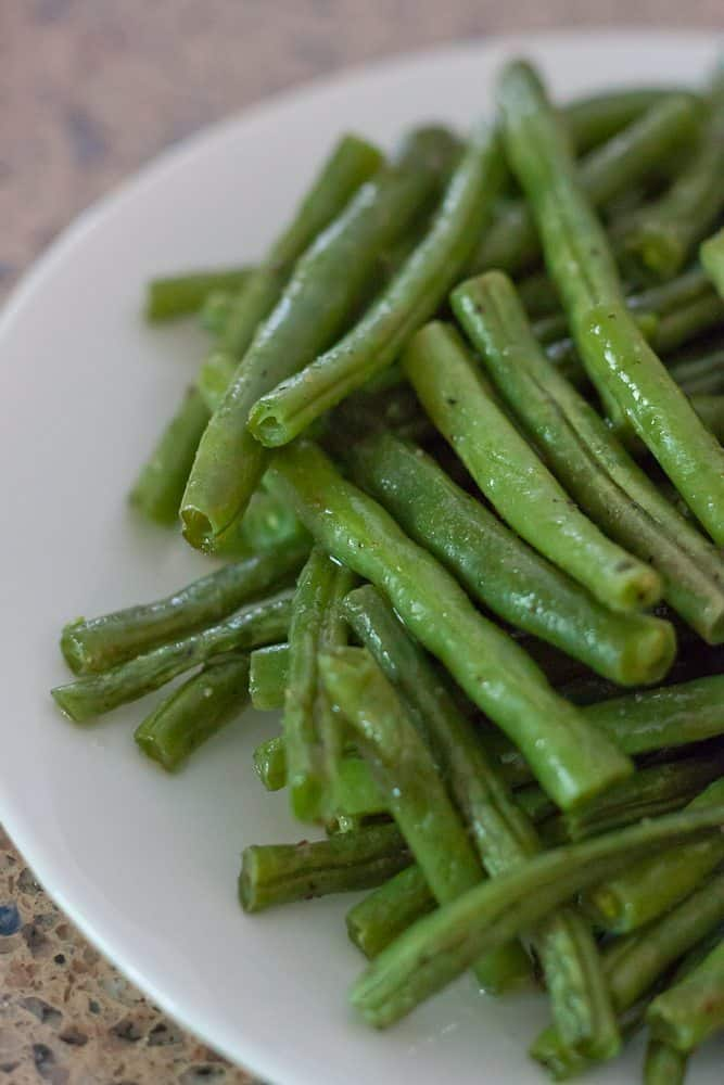 These Simple Roasted Green Beans are an easy vegetable side dish with just a few ingredients that make healthy living taste delicious!