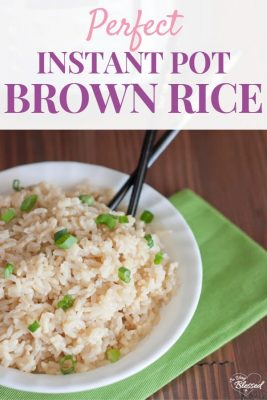 Bowl of brown rice with green onions and chopsticks with the text Perfect Instant Pot Brown Rice
