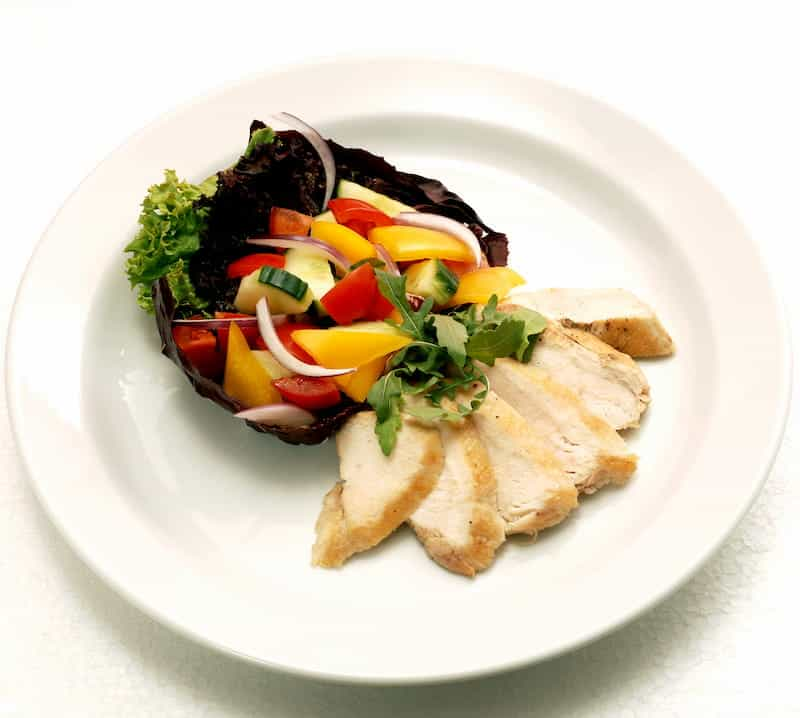 Plate of roasted chicken and vegetables