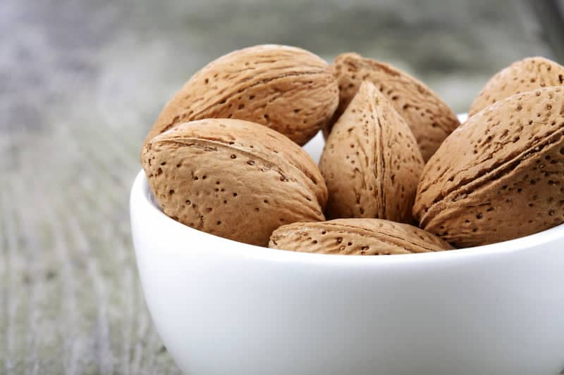 Bowl of unshelled almonds