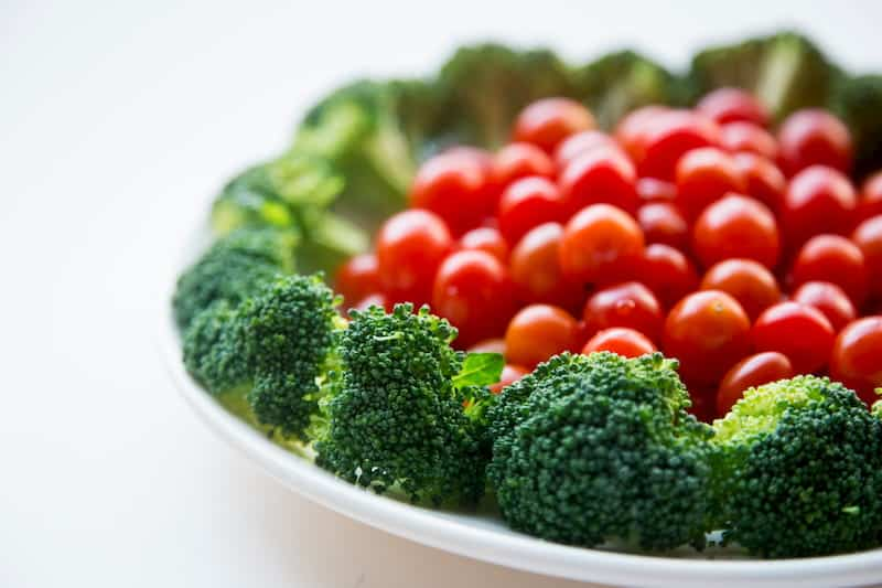 Broccoli and grape tomatoes on plate