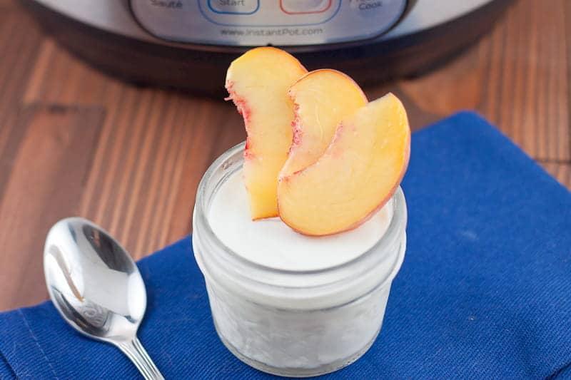 Mason jar of Greek yogurt with peaches