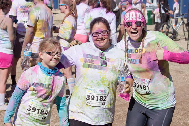 Friends posing after a Color Run 5k