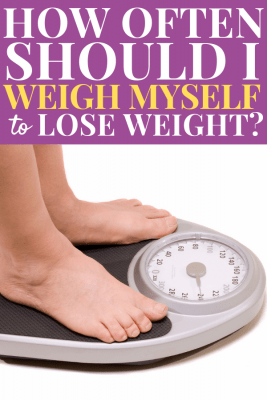 Feet stepping on scale - How often should I weight myself to lose weight?