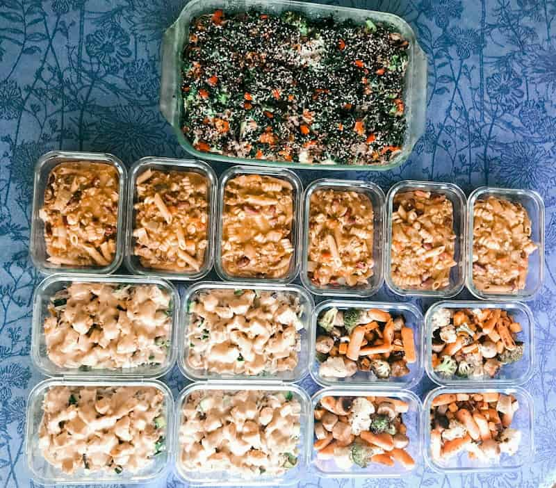 A table full of different meal prep containers full of healthy meal prep recipes