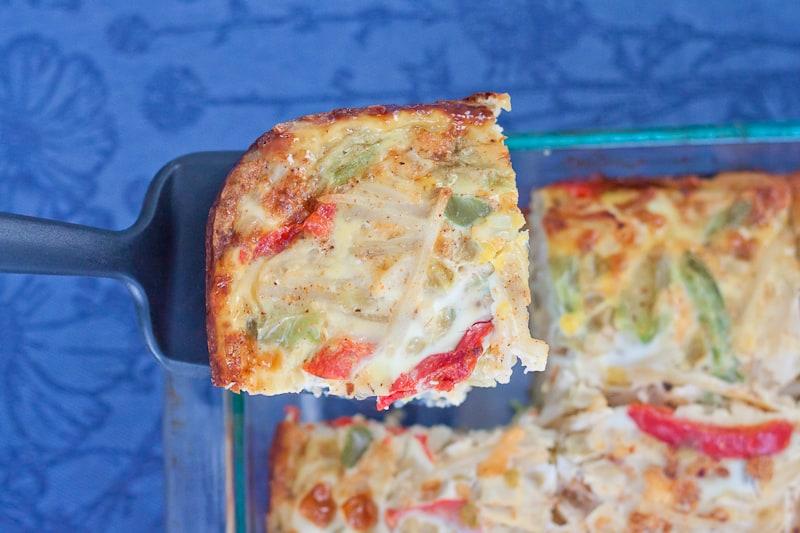 Spatula lifting piece of Fajita Veggie Breakfast Casserole out of the pan