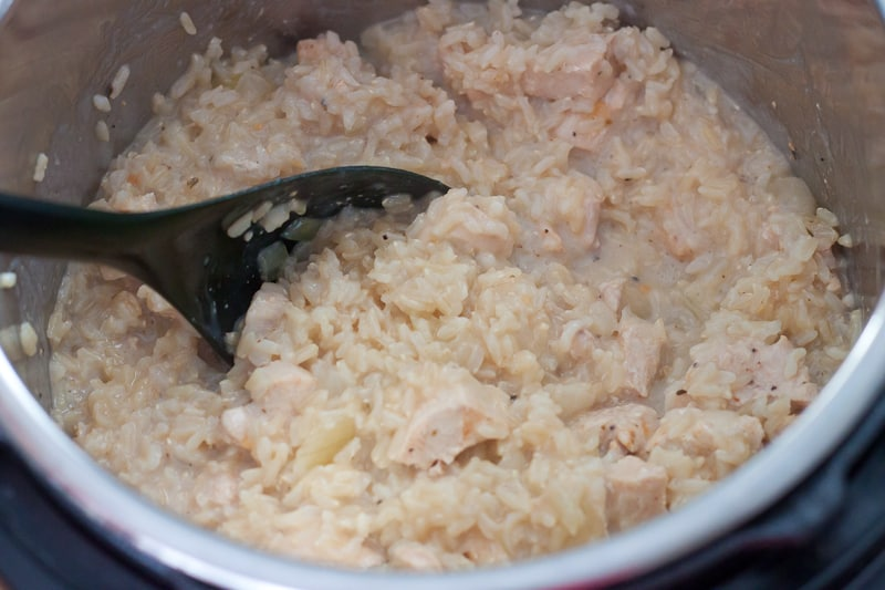 Cooked chicken & brown rice with milk mixture and broth
