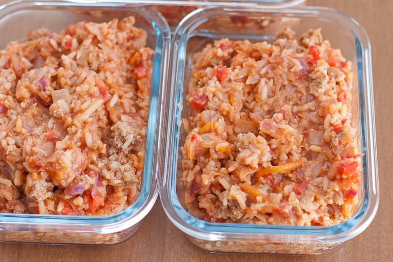 Glass meal prep containers full of unstuffed cabbage roll bowl