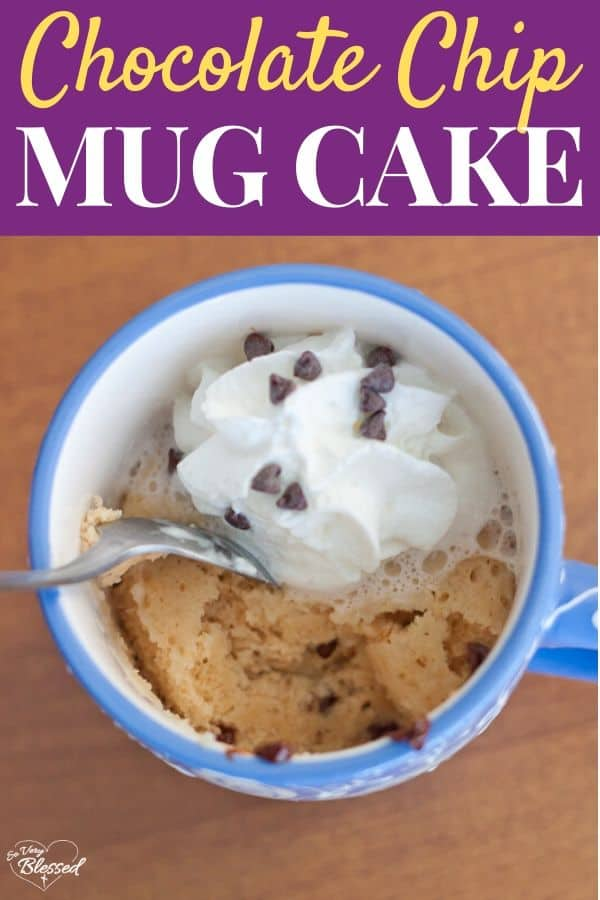 Healthy Chocolate Chip Mug Cake For One blue mug filled with mug cake topped with whipped cream and mini chocolate chips