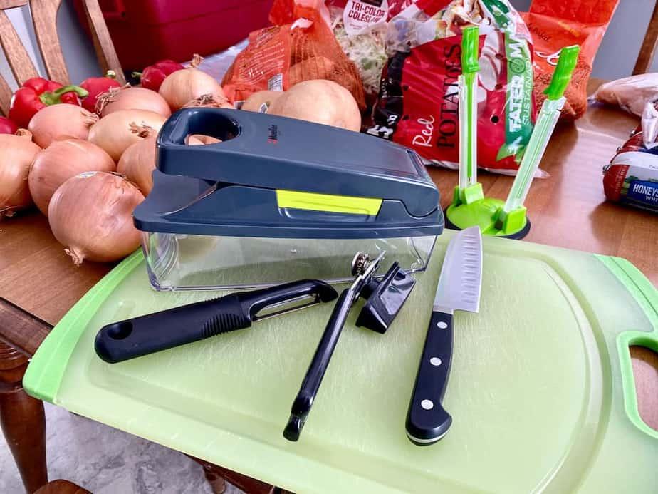 tools for freezer session - knife, cutting board, peeler, can opener, bag holder, vegetable chopper