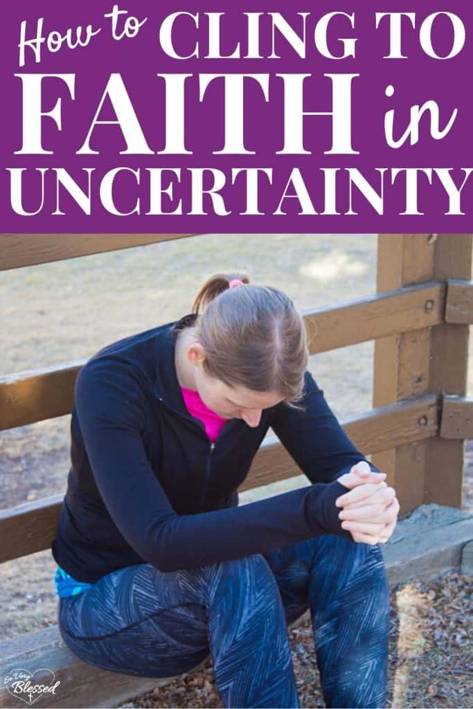 How To Cling To Faith in Uncertainty - woman on a bench bowing her head in prayer